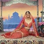 An Indian bride's veil can flow past her waist.