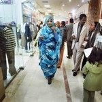 Sudanese woman walking in mall in Khartoum, Sudan