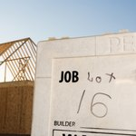 A close-up of a permit to build posted on a job site.
