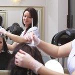 Woman having hair dyed in salon