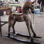 A vintage rocking horse at flea market