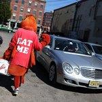 Man dressed in lobster costume walking in Portland, Maine