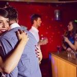A couple dances at a party.