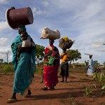 Sudanese villagers walking on road