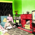 A family watches color television