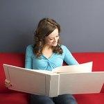 Woman looking through photo ablum