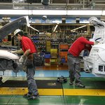 Workers assemble vehicles in Japan