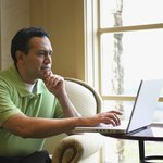 Man reading letter on laptop