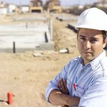 A portrait of a general contractor on a construction site.