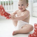 Toddler putting on boots