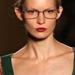 A runway model in a pair of wirerim rectangular frames that add an element of minimalism.