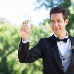 groom giving toast at wedding
