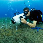 Scuba diver with an underwater camera