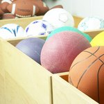 Boxes of sports balls and indoor playground