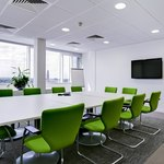 Bright green chairs in conference room
