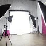 A studio with lights prepared for a photo shoot.