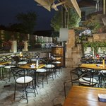 Relaxed Southern restaurant with wooden tables and New Orleans-inspired chairs.