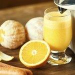 Orange juicer on table.