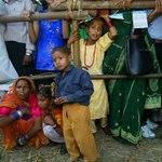 Nepalese villagers watch ceremony in Lumbini, Nepal