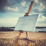 Canvas and easel at coast