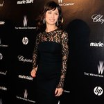 A simple, but elegant black dress, as worn by Actress Olga Kurylenko in 2012, works for many events.