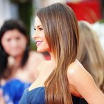A sleek, straight hairstyle, like Sophia Vergara's at the Golden Globes in 2012, will look good all day.