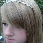 This bride has left her hair very simple and is wearing her tiara almost like a headband