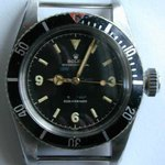 An early Rolex Submariner, also known as the James Bond watch.