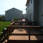 A sunny deck needs a chair and greenery.