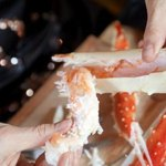 Alaskan king crab meat being pulled from shell