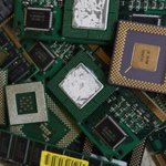Computer processors and circuit boards on scrap pile