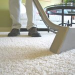 Carpet being cleaned with industrial vaccum