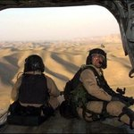 Troops with the U.S. Special Forces look out over Afghanistan from a Chinook helicopter.
