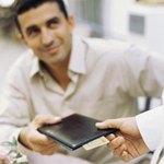 Man pays bill in restaurant