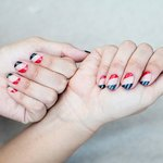 Festive nails in red and navy make a fun holiday statement.