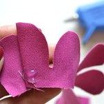 Continue adding glue to the bottom edge of the fabric.