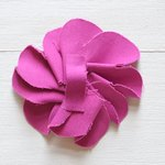 This step creates a fabric loop on the back side of the flower.