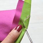 To make a guide, use a pen to draw a half teardrop shape along the fold.