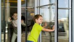 What Are the Public Safety Hazards of Electronic Doors in the Entry of a Business?