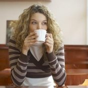 Woman sipping hot tea