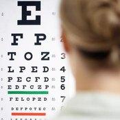 Woman reading Snellen eye chart.