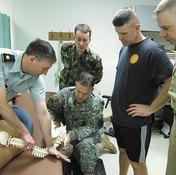 Doctor demonstrating spinal adjustment