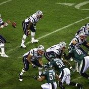 New England Patriots quarterback Tom Brady accepts a shotgun snap during Super Bowl XXXIX.