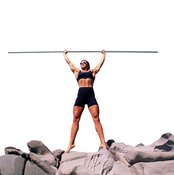 A pole or broomstick can be a valuable workout tool.