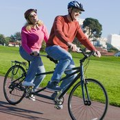 Tandem bicycles effectively combine two bikes onto a single elongated frame.