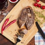 Cooked steak on table cutting board