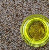 Flaxseeds and a glass of flaxseed oil.