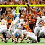 You can leap to block kick when you begin at the line of scrimmage.