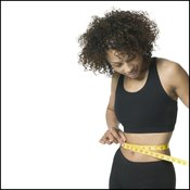 Diet and exercise will reduce your waist size.
