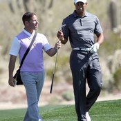 Swing coach Sean Foley, left, talks with Tiger Woods during the 2012 Accenture Match Play Championships.
